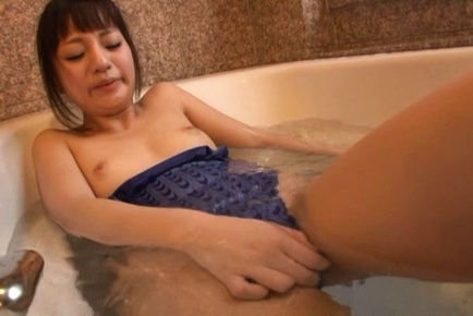 Attractive young chick Hitomi rubs her horny slit in a bathroom
